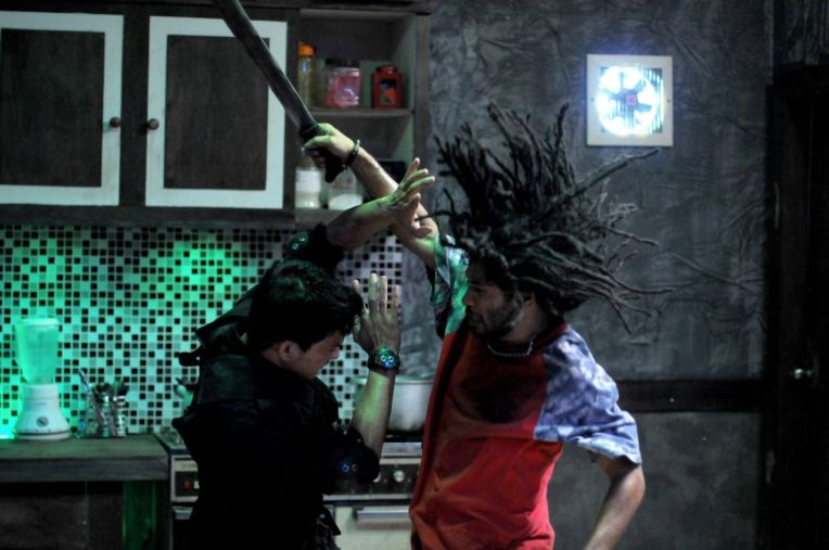 Iko Uwais, left, and Sofyan Alop in The Raid: Redemption
